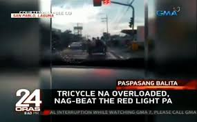 beating the red light paspasan overloaded na nga beating the red light pa ang tricycle