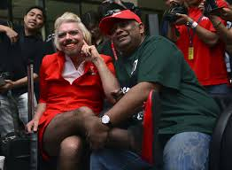 Hit The Floor On Bet - richard branson swaps suit for skirt to honor bet