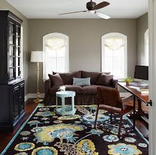 traditional home office with a vibrant rug and gray walls