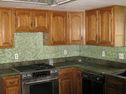 kitchens with glass tile backsplash l shape kitchen decoration using light green mosaic kitchen glass