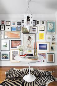 How To Arrange Pictures On A Wall by Arranging Photos On A Wall Minimalistic Design