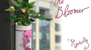 wall mounted planter the bloomer a modern wall mounted planter vase by revolution