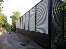 corrugated metal retaining wall with corrugated metal retaining