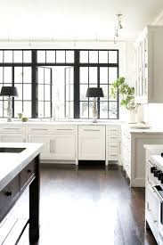 white kitchen with black steel windows see this instagram photo