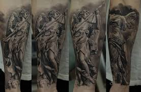 black and grey angel with sword tattoo on left arm
