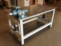 Woodworking Bench Top Plans by Workbench With Retractable Wheels A Pair Of Hydraulic Jacks And