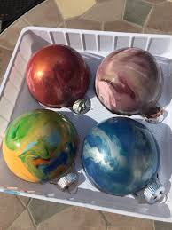 swirled some paint around inside glass ornaments now they look like