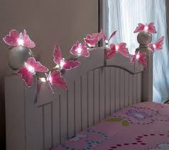 string lights on bedroom wall above bed interior decorationg and