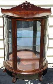 curved glass china cabinet child s curved glass china cabinet with north wind face brass