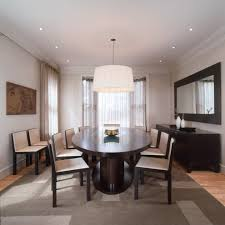 mirror behind dining table dining room contemporary with