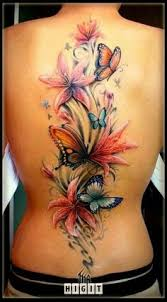 back and side beautiful flowers and butterflies tattoos