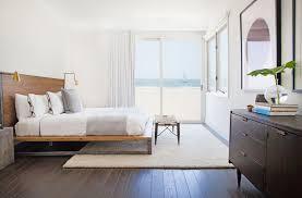 modern master bedroom with hardwood floors by orlando soria