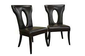 black leather chairs with oval hole on backrest and black wooden