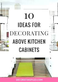 above kitchen cabinet decor ideas top of kitchen cabinet decorating ideas besttime4you info
