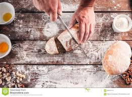Homemade Kitchen Table by Cutting Homemade Bread On Kitchen Table Flat Lay Stock Photo