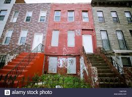 New York Homes Neighborhoods Architecture And Real Estate Dilapidated Brownstones And Homes On Van Buren Street In The Stock
