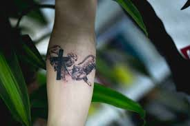 forearm cross tattoo portfolio playhouse tattoo studio