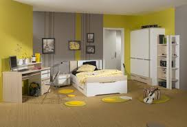 gray and yellow bedroom walls white framed bed with storage