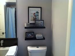 black two tiers floating over toilet shelf in light grey bathroom