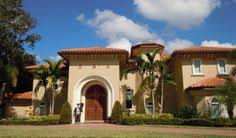 tuscan style home with terracotta roof and arches ravida