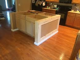 how to make a kitchen island using cabinets stock cabinets and some custom framing make for a great diy