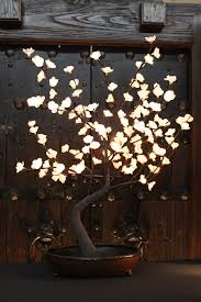 pre lit branches decorating white lighted branches with glass vase for