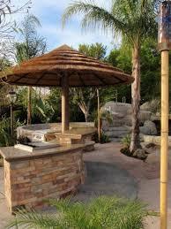 tiki umbrella with stone half circular inexpensive outdoor kitchen
