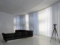 Pinch Pleated Semi Sheer Curtains Motorized Sheer Pinch Pleat Curtain Installed On A Curved Glass