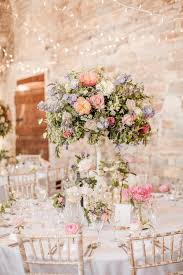 20 truly stunning tall wedding centrepieces barn wedding flowers