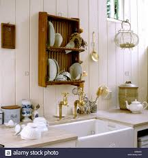 country kitchen with sink and wooden dish rack in english country