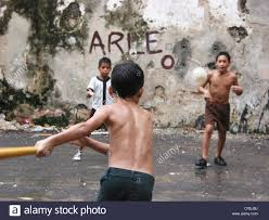 children playing baseball in a backyard in the old town cuba la
