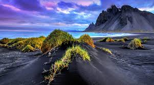 Black Sand Beaches by Black Sand Beach Iceland Sea Mountain Cliff Grass Clouds