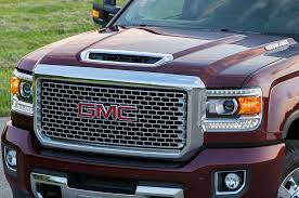 gmc teases new duramax with photos of 2017 hood scoop