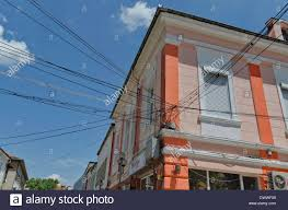 old renovate house in small town overladen with wires stock photo