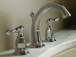 bathroom ideas curved chrome kohler bathroom faucets above round