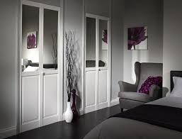 Bi Fold Doors For Closets by Contemporary White Wooden Bi Fold Door Decor With Half Mirror As