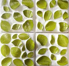 handmade 3d leaves pattern wall tile featuring green accent leaves