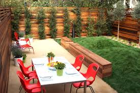 Fence Line Landscaping by Fence Line Landscaping Landscape Modern With White Side Table