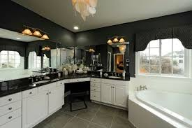 The New House NumberNineteen - Black granite with white cabinets in bathroom
