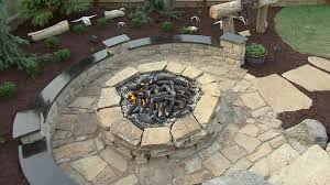 Building A Raised Patio With Retaining Wall by How To Build A Stone Fire Pit How Tos Diy