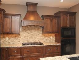 travertine and glass backsplash black appliances stained