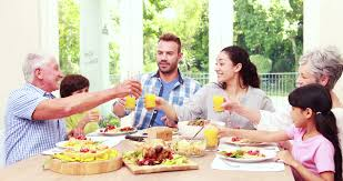 happy family toasting during lunch at home stock footage