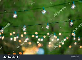 Hanging Christmas Lights by Hanging Decorative Christmas Lights Back Yard Stock Photo 72658555