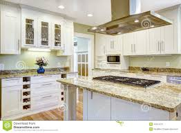 kitchen island with built in stove granite top and hood stock