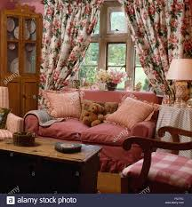 Country Living Room by Floral Curtains On Window Behind A Pink Sofa In Country Living