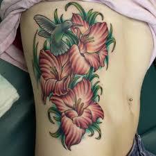 gladiolus flower bouquet tattoo on leg