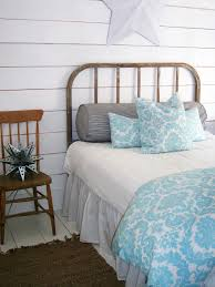 distressed iron single bed using blue white beach theme cover and