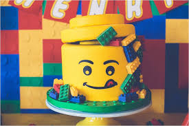 kara u0027s party ideas lego face cake from a lego birthday party via
