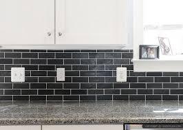 New Caledonia Granite Countertop White Kitchen Cabinets With Black - Black backsplash