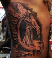 sad angel tattoo on side for women photos pictures and sketches